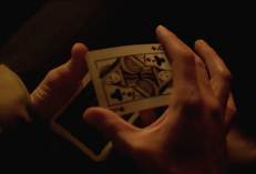 John's hands shuffling cards