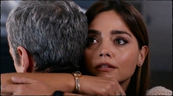 Clara hides her pain in a hug