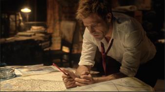 John examining a map
