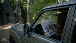 Zed with her drawing of the millhouse