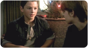 "Sam gives Dean the amulet he got from Bobby in ""A Very Supernatural Christmas"""