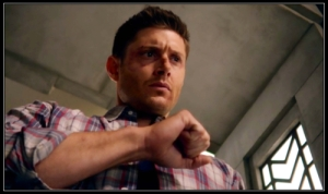 Dean Winchester (Jensen Ackles) examines his hands thinking about the Mark of Cain