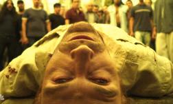John wakes up after the chapel massacre