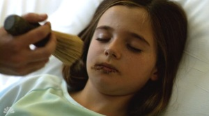John brushes Geraldine's face with Crowley's shave brush