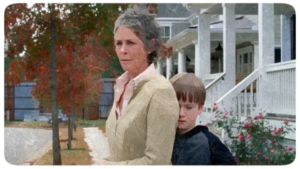 Carol shelters Sam from the fight between Rick and Pete