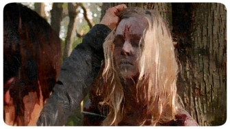 Daryl and Aaron find a women tied to a tree with a W on her forehead