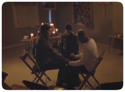 Sasha, Maggie, and Father Gabriel pray together