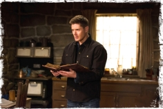 Dean holding book Supernatural The Book of the Damned