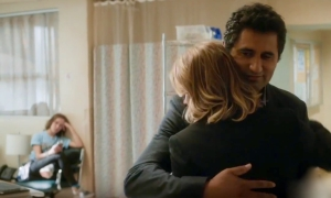 Travis Manaway (Cliff Curtis) hugs Madison Clark (Kim Dickens) at the hospital while Alicia Clark (Alycia Debnam-Carey) sits in the background.