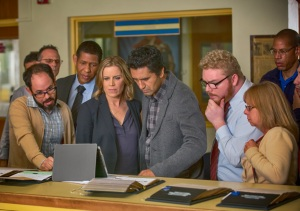 Madison Clark (Kim Dickens) and Travis Manaway (Cliff Curtis), along with school staff, watch the shooting video. Photo by Justin Lubin/AMC