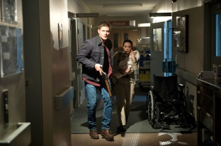 Dean running Supernatural Out of the Darkness Into the Fire