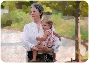 Carol Peletier holds Judith The Walking Dead Heads Up