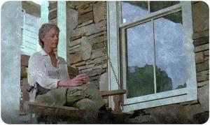 Carol sitting The Walking Dead Twice as Far