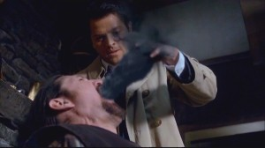Castiel excises a demon