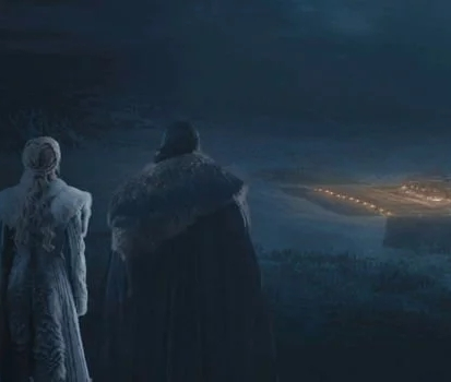 Daenerys Targaryen (Emilia Clarke) and Jon Snow (Kit Harington) watch Winterfell from afar