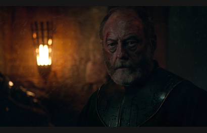 Davos Seaworth (Liam Cunningham) watches the Red Woman fulfill her final prophesy
